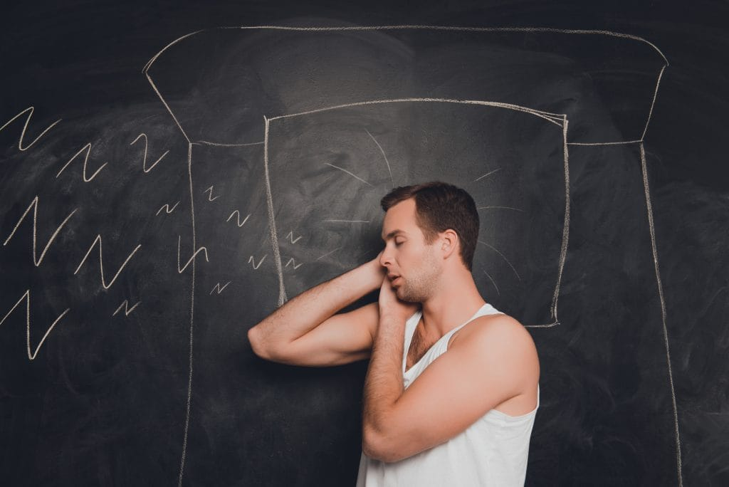 Young man against the background of chalkboard sleeping and snor